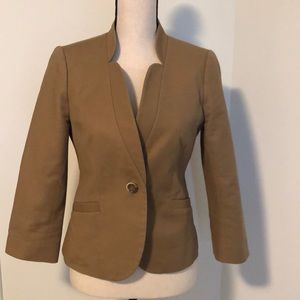 Limited tan 3/4 length jacket.